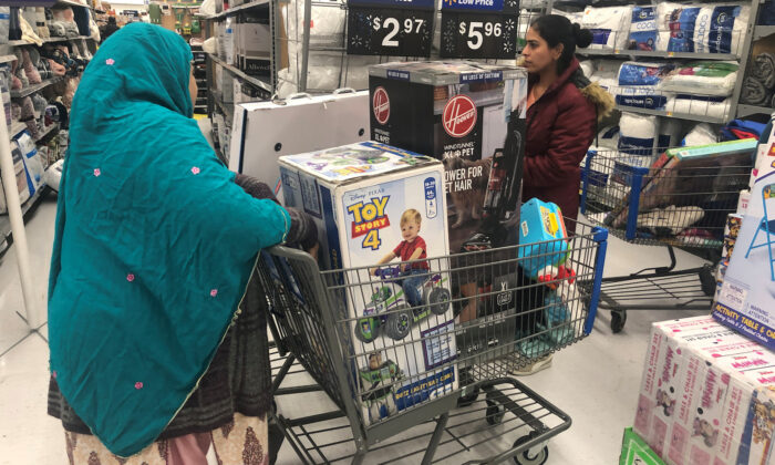 People shop during a sales event on Thanksgiving day at Walmart in Westbury, N.Y., on Nov. 28, 2019. (Shannon Stapleton/Reuters)