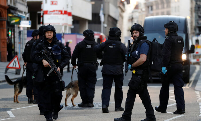 Police officers are seen near the site of an incident at London Bridge in London, Britain on Nov. 29, 2019. (Peter Nicholls/Reuters)