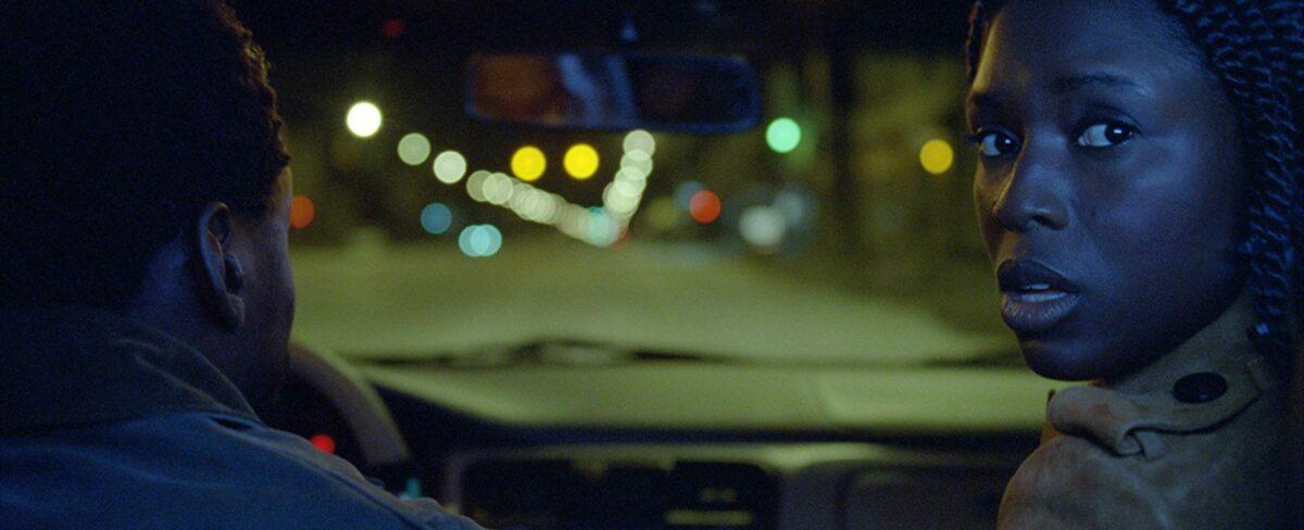 Man drives woman in car