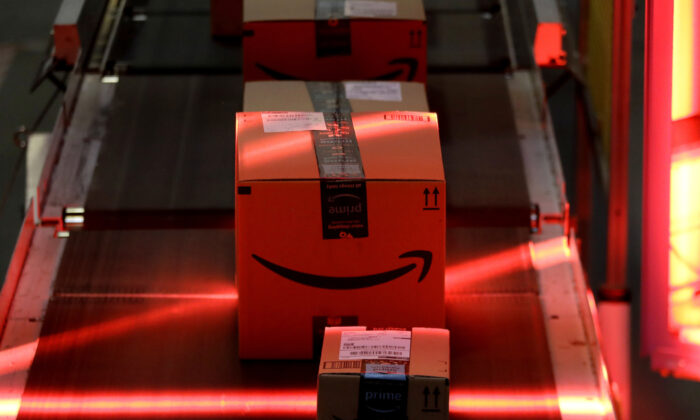 Packages riding on a belt are scanned to be loaded onto delivery trucks at the Amazon Fulfillment center in Robbinsville Township, N.J. on Aug. 1, 2017. (Julio Cortez/AP/File)