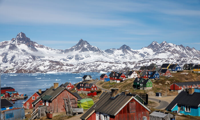 Snow covered mountains rise above the harbor and town of Tasiilaq, Greenland on June 15, 2018. (Lucas Jackson/Reuters)