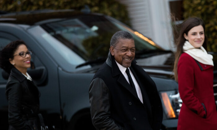 Robert Johnson, center, the founder of Black Entertainment Television, arrives for a meeting with president-elect Donald Trump at Trump International Golf Club in Bedminster Township, New Jersey on Nov. 20, 2016. (Drew Angerer/Getty Images)