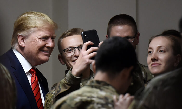 President Donald Trump poses for selfies during a Thanksgiving dinner with U.S. troops at Bagram Air Field in Afghanistan on Nov. 28, 2019. (Olivier Douliery/AFP via Getty Images)