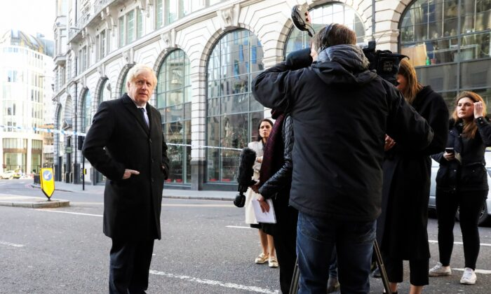 Britain's Prime Minister Boris Johnson speaks to the media at the scene of a stabbing on London Bridge, in which two people were killed, in London, Britain on Nov. 30, 2019. (Simon Dawson/Pool/Reuters)