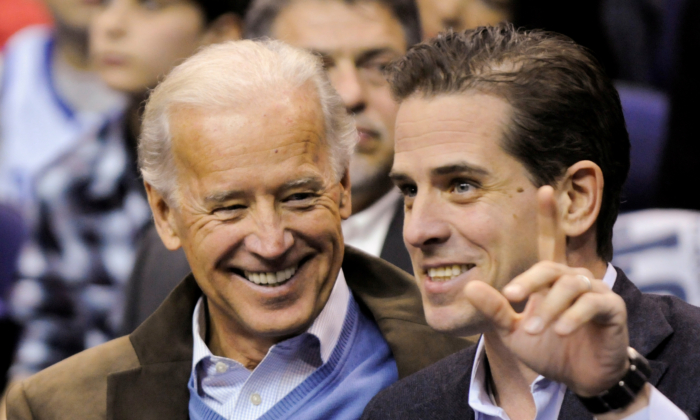 Vice President Joe Biden and his son Hunter Biden attend an NCAA basketball game between Georgetown University and Duke University in Washington on Jan. 30, 2010. (Jonathan Ernst/Reuters)