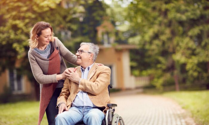 Stock photo of a man in wheelchair. (Lucky Business/Shutterstock)