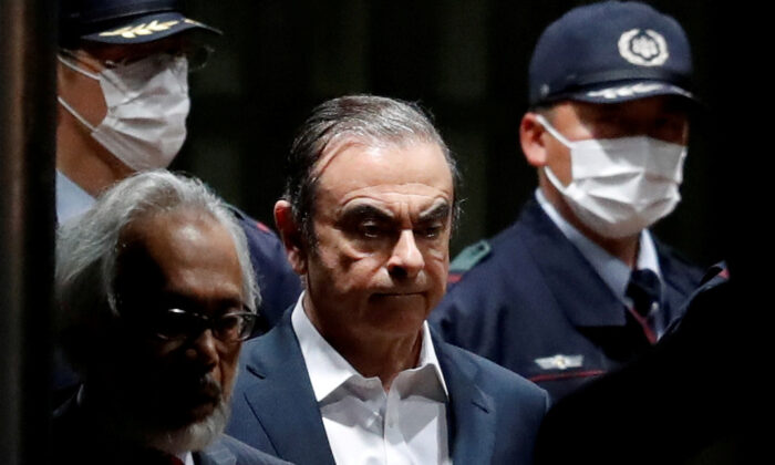Former Nissan Motor chairman Carlos Ghosn leaves the Tokyo Detention House in Tokyo, Japan, on April 25, 2019. (Issei Kato/Reuters)