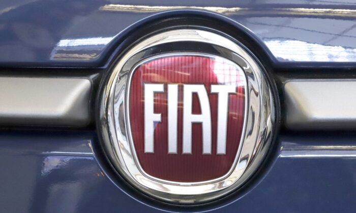 The Fiat logo is mounted on a 2019 500 L on display at the 2019 Pittsburgh International Auto Show in Pittsburgh on Feb. 14, 2019. (Gene J. Puskar/AP Photo)