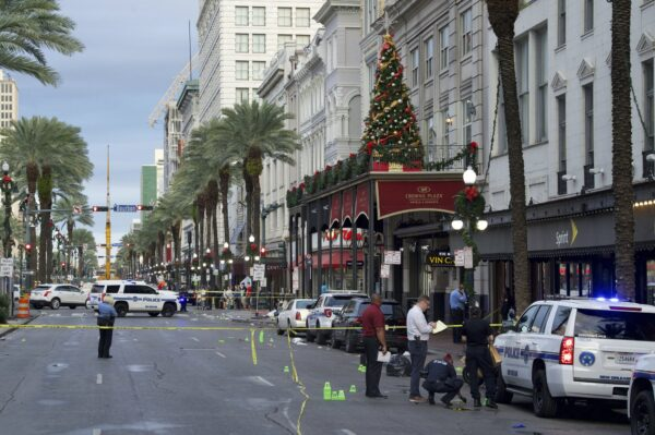 New Orleans police investigate the scene of a shooting