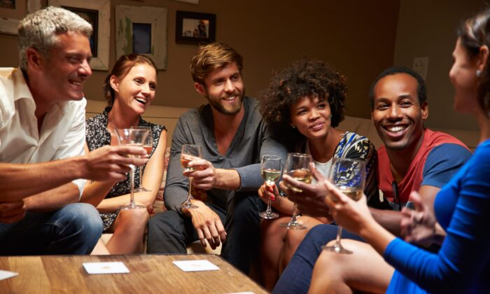 A night with friends is more than a pleasant way to pass time, it is an essential human need and a way to create a sense of belonging for yourself and others. (Monkey Business Image/Shutterstock)