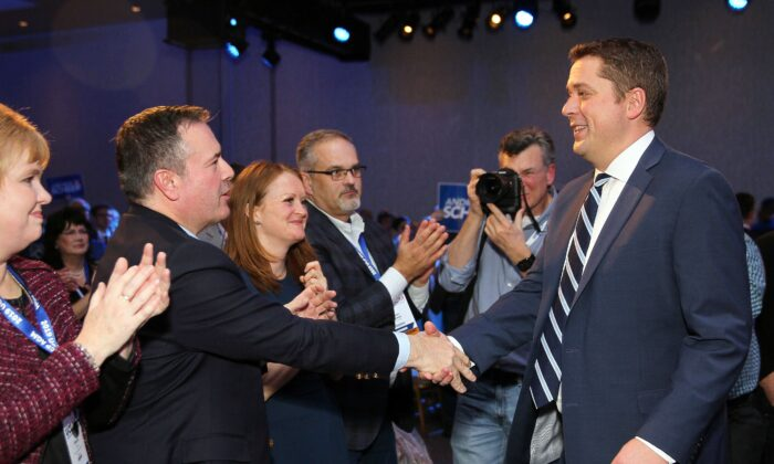 Conservative Party Leader Andrew Scheer shakes hands with Alberta Premier Jason Kenney after his keynote speech at the Alberta United Conservative Party AGM in Calgary on Nov. 29, 2019. (The Canadian Press/Dave Chidley)