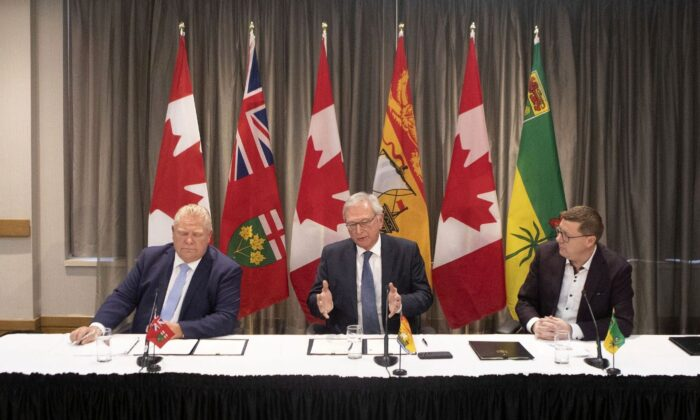 "(L-R) Ontario Premier Doug Ford, New Brunswick Premier Blaine Higgs, and Saskatchewan Premier Scott Moe talk to the media in Toronto on Dec. 1, 2019. The premiers signed a ""Collaboration Memorandum of Understanding"" ahead of a meeting of Canada's provincial leaders on Dec. 2. (The Canadian Press/Chris Young)"