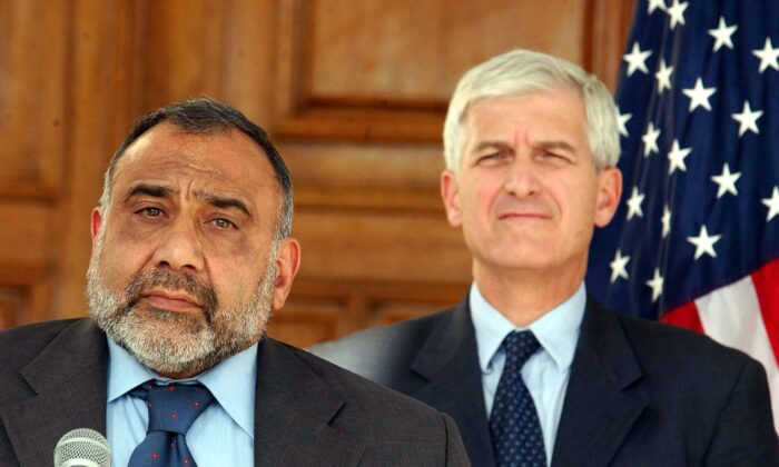 Adil Abdul-Mahdi (L) speaks while U.S. Undersecretary of State, Economic, Business, and Agriculture Affairs Alan P. Larsen (R) listens during a press conference at Convention Center Sept. 18, 2004 in Baghdad, Iraq. (Mohammed Messara-Pool/Getty Images)