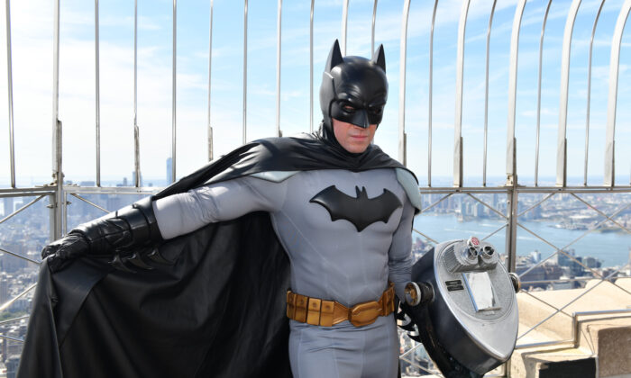 Batman celebrated his 80th birthday by visiting Gotham' most iconic sky scraper, the Empire State Building in New York City on Sept. 20, 2019. (Craig Barritt/Getty Images for Warner Bros Consumer Products)