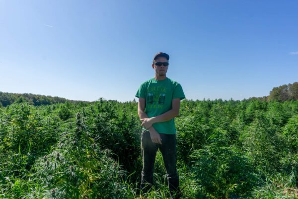 Dylan Barber standing in front of his 3-acre hemp field on Sept. 20, 2019. (Courtesy of Dylan Barber)