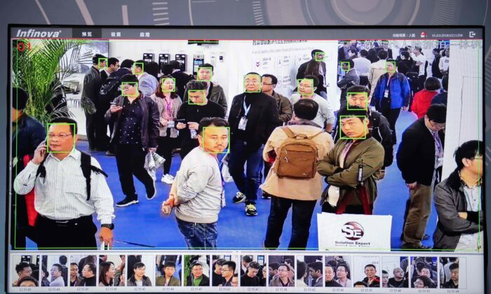 A screen shows visitors being filmed by AI (Artificial Inteligence) security cameras with facial recognition technology at the 14th China International Exhibition on Public Safety and Security at the China International Exhibition Center in Beijing on October 24, 2018. (NICOLAS ASFOURI/AFP via Getty Images)