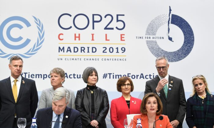 US House Speaker Nancy Pelosi (R) and US Senator Sheldon Whitehouse (D-RI) give a press conference during the UN Climate Change Conference COP25 at the 'IFEMA - Feria de Madrid' exhibition centre, in Madrid, on December 2, 2019. PIERRE-PHILIPPE MARCOU/AFP via Getty Images