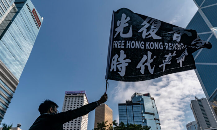 Professionals from advertising sector take part in a rally to commence a five day strike in Hong Kong on Dec. 2, 2019. (Anthony Kwan/Getty Images)