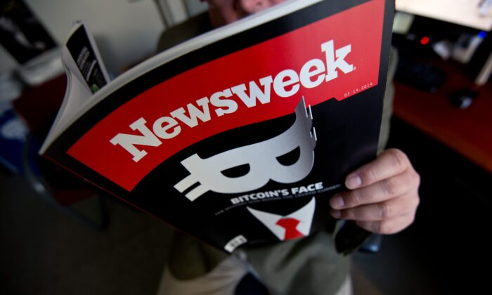 This photo illustration shows a man reading a copy of the new print edition of Newsweek magazine in Washington on March 10, 2014. (Nicholass Kamm/AFP via Getty Images)