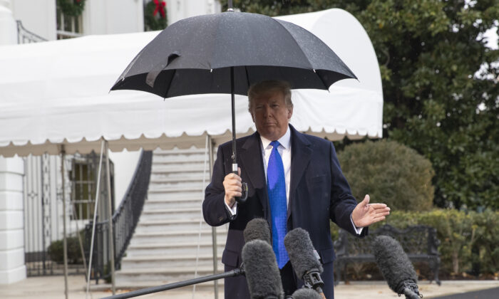 President Donald Trump speaks with reporters on the South Lawn of the White House in Washington before departing to NATO meetings in Europe, on Dec. 2, 2019. (Alex Brandon/AP Photo)