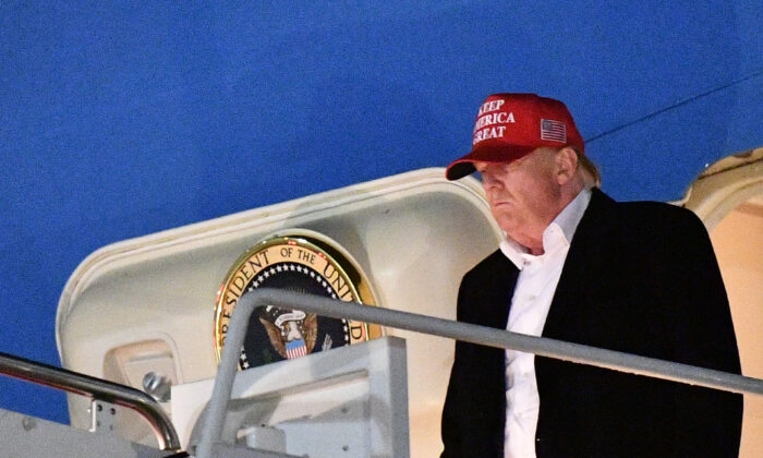 President Donald Trump steps off Air Force One upon arrival at Andrews Air Force Base, Maryland on Dec. 1, 2019. (Mandel Ngan/AFP via Getty Images)