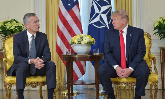 In this handout provided by NATO, Jens Stoltenberg, Secretary General of NATO speaks with U.S. President Donald Trump ahead of the NATO Leaders meeting at the NATO HQ on December 3, 2019 in Watford, England. (Photo by NATO handout via Getty Images)