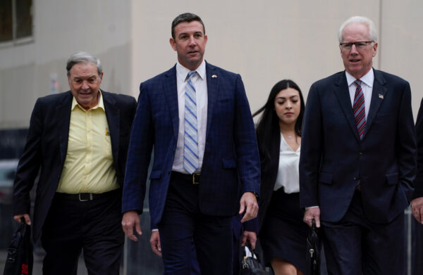 U.S. Representative Duncan Hunter arrives at court with his father Duncan Hunter Sr. and his lawyer, where he is expected to plead guilty to federal charges stemming from allegations that he and his wife misused campaign funds in San Diego