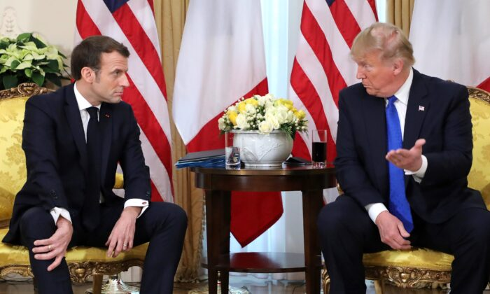 President Donald Trump (R) France's President Emmanuel Macron react as they talk during their meeting at Winfield House, London on Dec. 3, 2019. (Ludovic Marin/AFP via Getty Images)