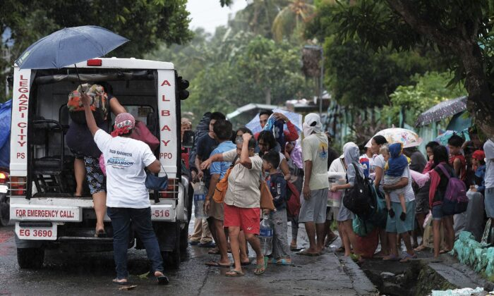 Residents evacuate their area in preparation for the coming of Typhoon Kammuri in Legazpi, Albay province, southeast of Manila, Philippines on Dec. 2, 2109. (AP)
