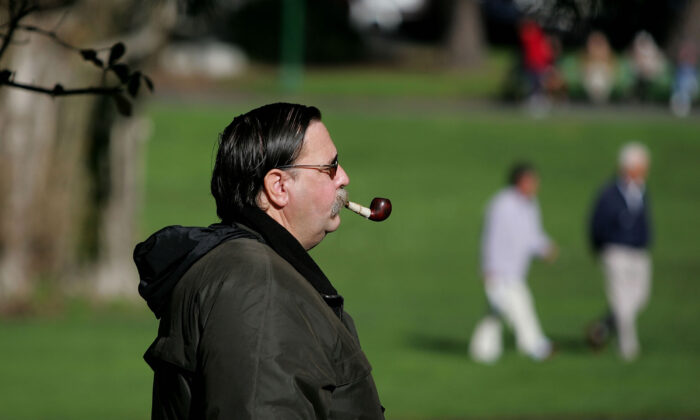 A man smokes a pipe as he walks through Washington Square Park in San Francisco, Calif., on Jan. 26, 2005. (Justin Sullivan/Getty Images)