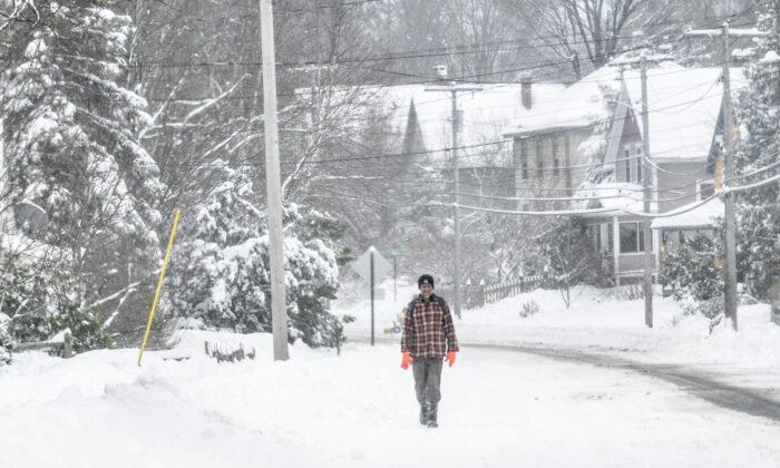 A man walks on South Main Street in Brattleboro, Vt., on Dec. 2, 2019. (Kristopher Radder/The Brattleboro Reformer via AP)