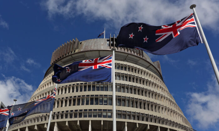 New Zealand flags fly in front of The Beehive during the Commission Opening of Parliament at Parliament in Wellington, New Zealand on Oct. 20, 2014. (Hagen Hopkins/Getty Images)