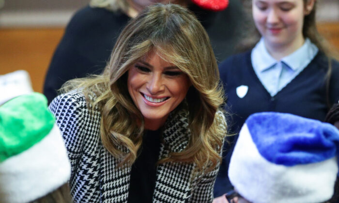 U.S. First Lady Melania Trump smiles amongst children during a visit at the Salvation Army Clapton centre, as the NATO summit takes place in Watford, in London, Britain, on Dec. 4, 2019. (Lisi Niesner/Reuters)