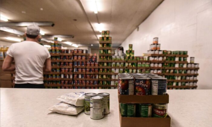 A worker places packaged food onto a counter inside of a food distribution center on the Cheyenne River Indian Reservation in Eagle Butte, South Dakota, on Jan. 25, 2019. (Stephanie Keith/File Photo/Reuters)