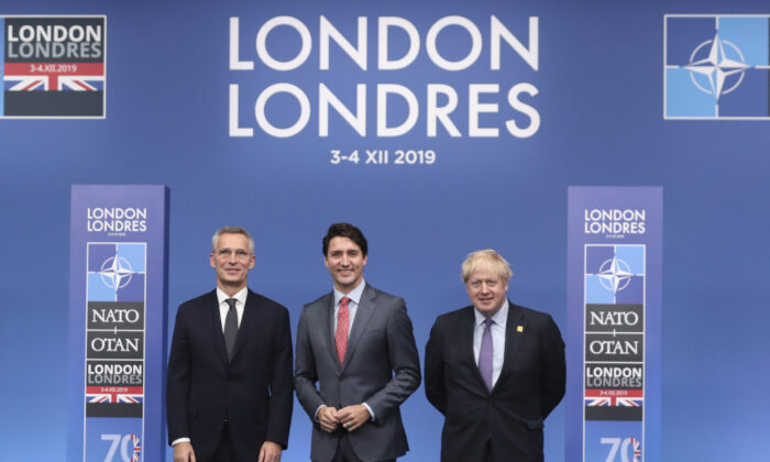 NATO Secretary General Jens Stoltenberg (L) and British Prime Minister Boris Johnson welcome Canadian Prime Minister JustinTrudeauat the NATO leaders meeting in Watford, Hertfordshire, England on Dec. 4, 2019. (AP Photo/Francisco Seco)