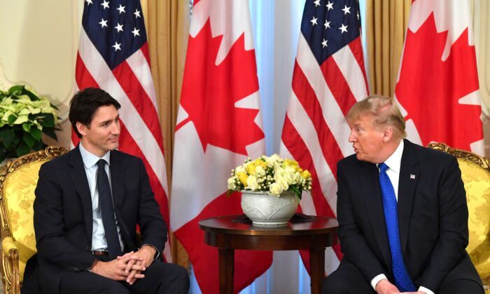 U.S. President Donald Trump (R) talks with Canada's Prime Minister Justin Trudeau during a meeting at Winfield House, London on Dec. 3, 2019. (Nicholas Kamm/AFP via Getty Images)