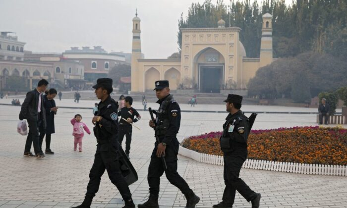 Uyghur security personnel patrol near the Id Kah Mosque in Kashgar in western China's Xinjiang region, on Dec. 4, 2019. (AP Photo/Ng Han Guan)