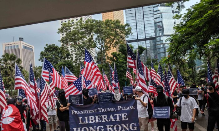 Protesters in Hong Kong raise U.S. flags asking for President Donald Trump's support in September 2019. (Daniel Wang)