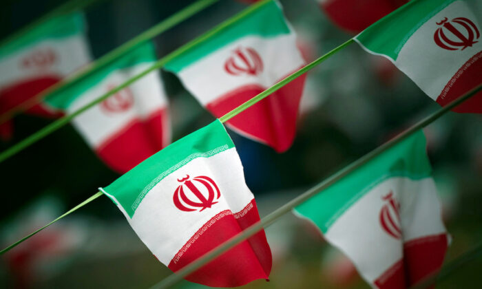 Iran's national flags are seen on a square in Tehran on Feb. 10, 2012, a day before the anniversary of the Islamic Revolution. (Morteza Nikoubazl/Reuters)