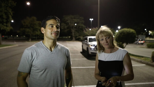 Former Bexar County Criminal District Attorney Nico LaHood with ÈVaxxed II: The People's TruthÈ executive producer Polly Tommey after signing his allegedly vaccine-injured son's name, Michael, to the Vaxxed bus. (© Vaxxed II: The People's Truth)