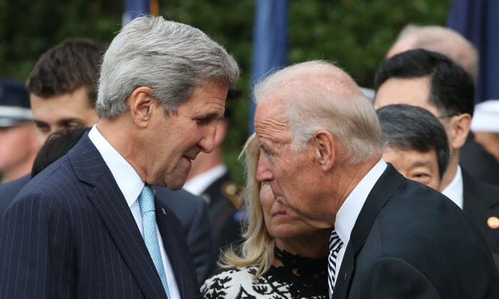 Then-Vice President Joe Biden, right, speaks with then-Secretary of State John Kerry in Washington in a 2015 file photograph. (Mark Wilson/Getty Images)