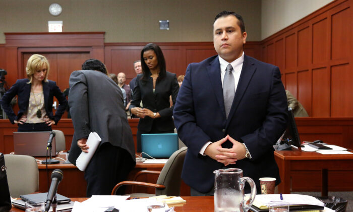 George Zimmerman (R) stands at the start of the fourth day of his murder trial in Seminole circuit court in Sanford, Fla., on June 13, 2013. (Joe Burbank-Pool/Getty Images)