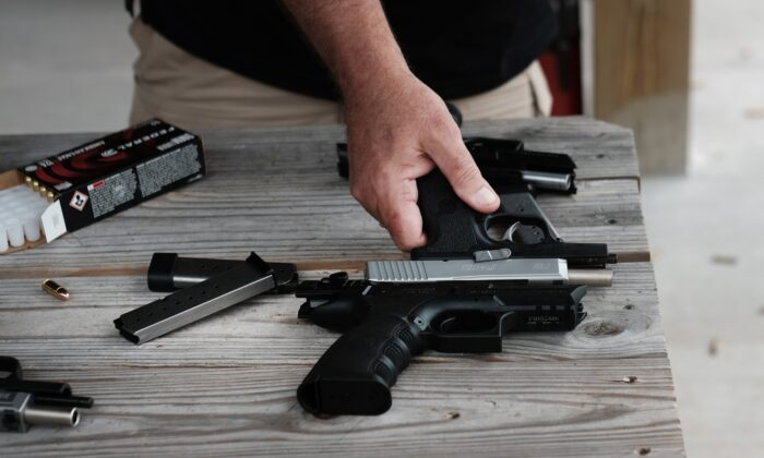 """Pistols at a shooting range during the """"Rod of Iron Freedom Festival"""" in Greeley, Penn., on Oct. 12, 2019. (Spencer Platt/Getty Images)"""