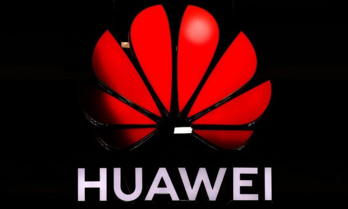 An illuminated Huawei sign is on display during an event in Zurich, Switzerland, on Oct. 15, 2019. (Stefan Wermuth/AFP via Getty Images)