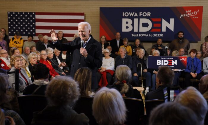 Democratic presidential candidate former Vice President Joe Biden speaks to local residents during a bus tour stop in Mason City, Iowa, on Dec. 3, 2019. (Charlie Neibergall/AP Photo)