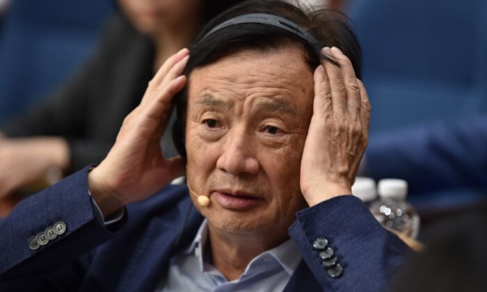 Huawei founder and CEO Ren Zhengfei adjusts his headphones as he hosts a panel discussion in Shenzhen, China, on June 17, 2019. (Hector Retamal/AFP via Getty Images)