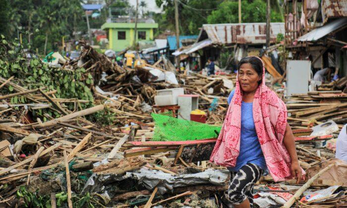 A resident walks past debris from her destroyed houses after Typhoon Kammuri hit the city of Sorsogon, south of of Manila, on Dec. 3, 2019. (RAZVALE SAYAT/AFP via Getty Images)
