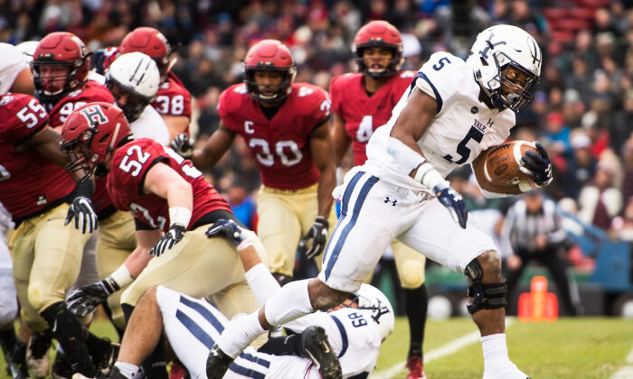 Alan Lamar #5 of the Yale Bulldogs scores a touchdown during a game against the Harvard Crimson at Fenway Park on Nov. 17, 2018 in Boston, Mass. (Adam Glanzman/Getty Images)