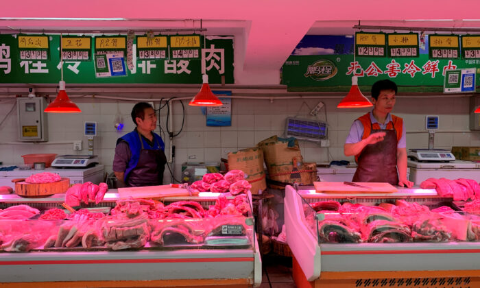 Pork vendors' stalls at a market in Beijing, China on Nov. 11, 2019. (Fang Nanlin/Reuters)