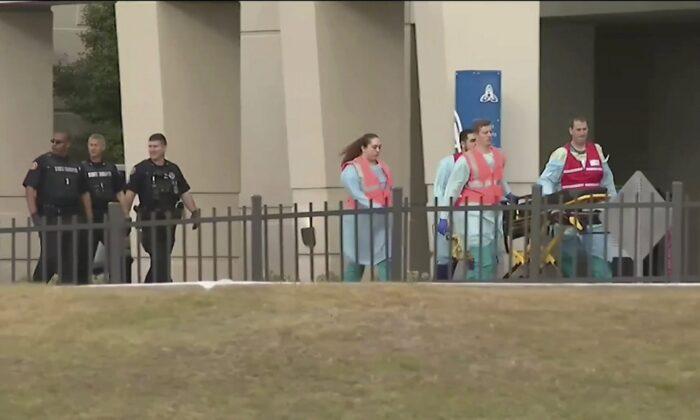 Emergency responders near the Naval Air Base Station in Pensacola, Fla., on Dec. 6, 2019. (WEAR-TV via AP)